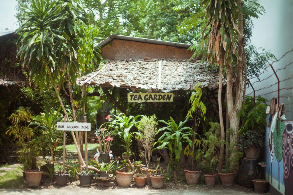 Tea Garden w Sign Plants